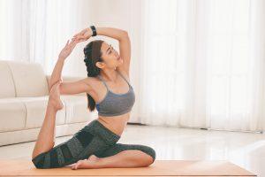 Sportive woman training on mat