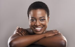 Beautiful nude black woman with flawless skin and charming smile